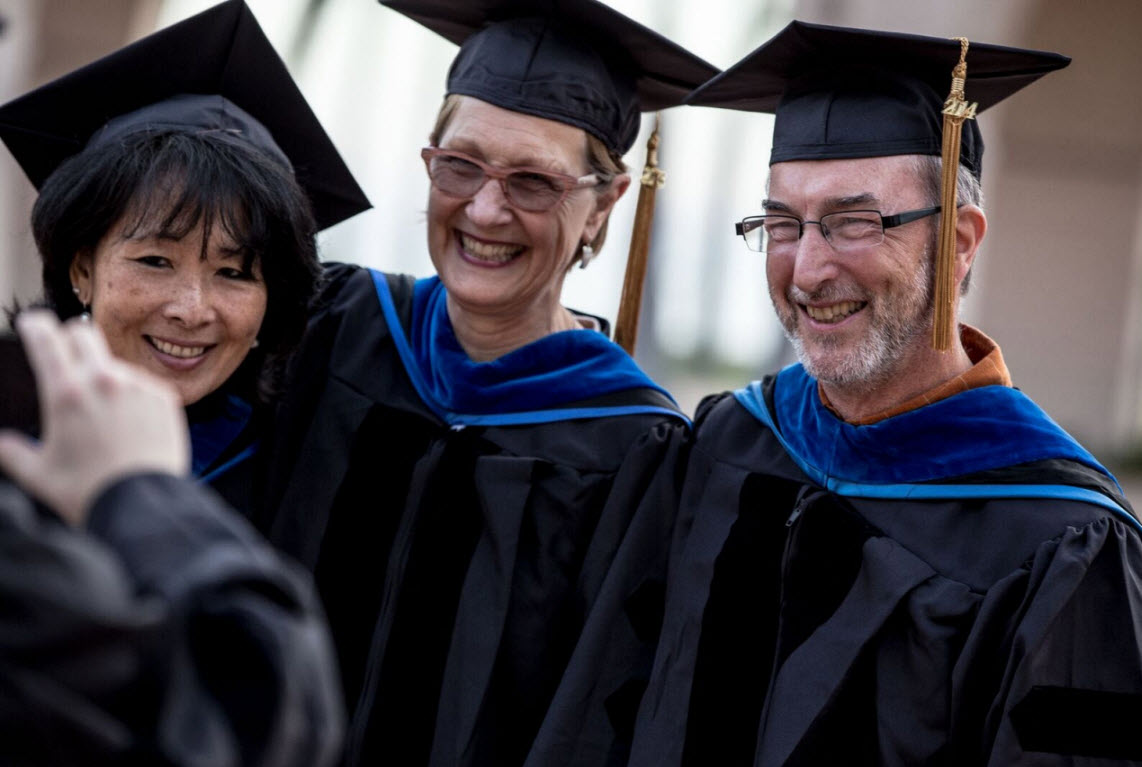 Graduates from the 2015 ceremony: from left to right: Valerie Nishi, PhD, Alison Granger-Brown, PhD and Paul Stillman, PhD